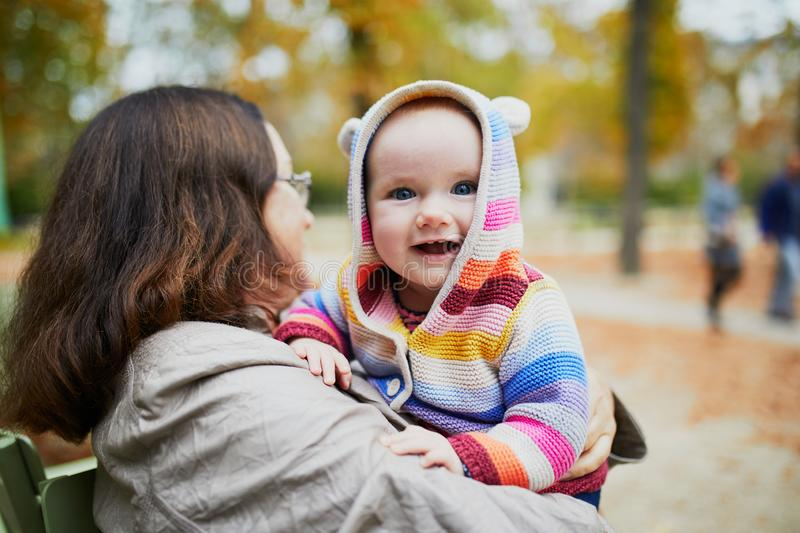Grandmother and granddaughter together in autumn park stock image