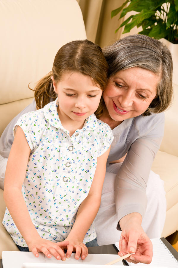 Download Grandmother With Granddaughter Use  Computer Stock Image - Image: 23458449