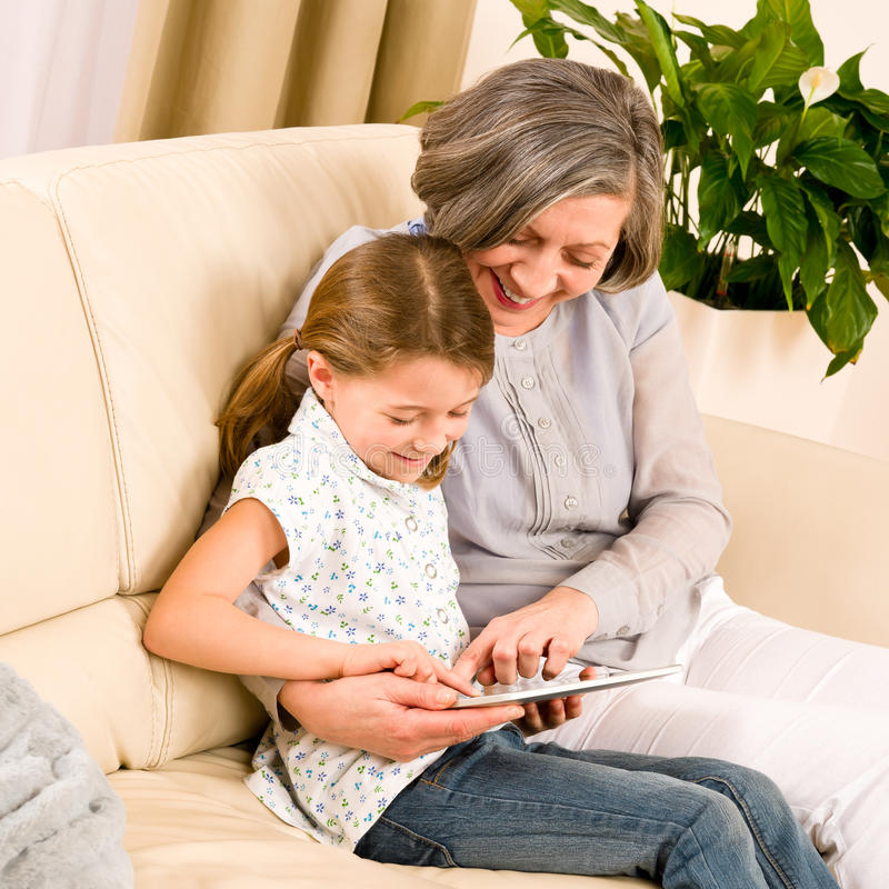 Download Grandmother With Granddaughter Use Touch Tablet Stock Image - Image: 23458485
