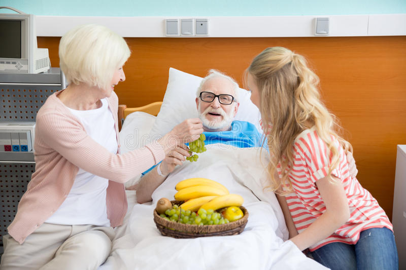 Grandmother and granddaughter visiting patient stock photography
