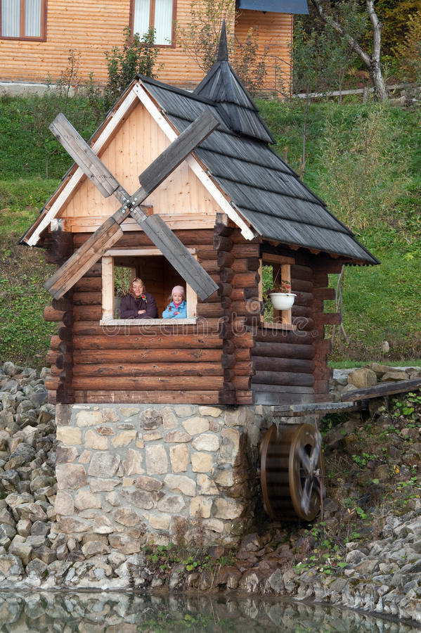 Grandmother and granddaughter in wooden house stock image