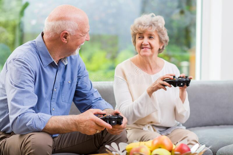 holding pads and playing video game stock image