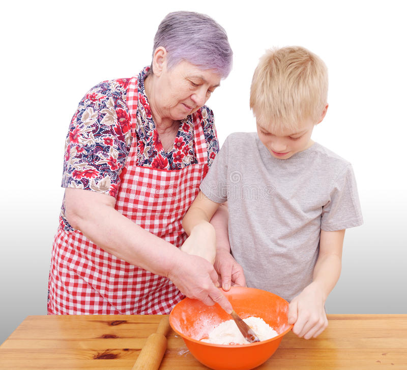 The grandmother and the grandson bake royalty free stock photography
