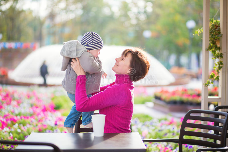 Grandmother and grandson in cafe royalty free stock image