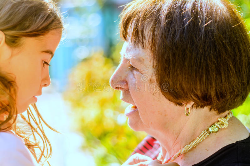Grandmother having a conversation with her Granddaughter royalty free stock photos