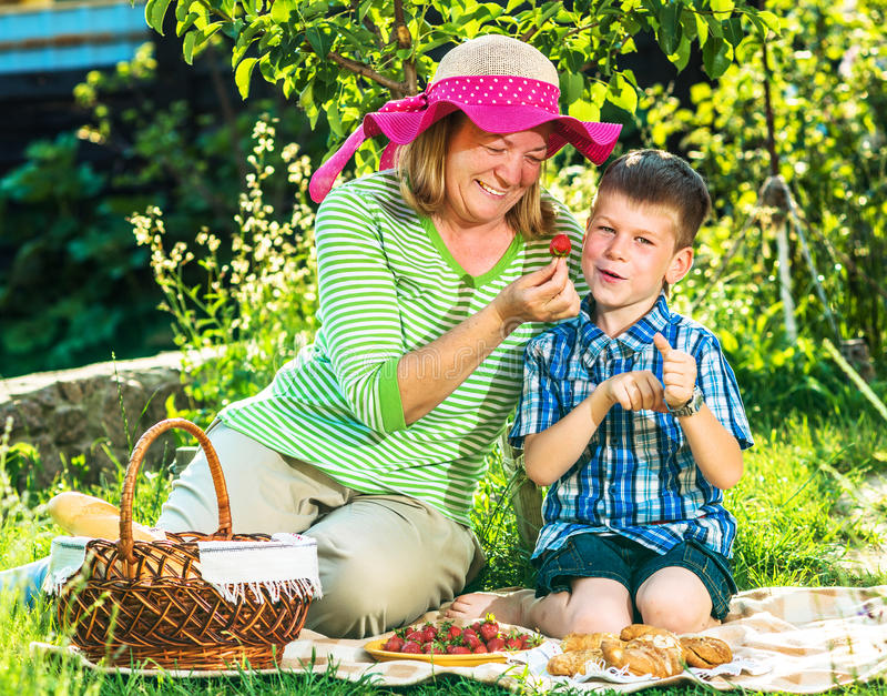 Grandmother having a picnic with grandchild stock photos