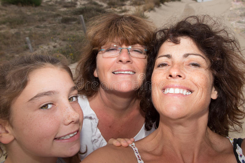 Grandmother with her daughter and grand daughter looking at the camera stock photo