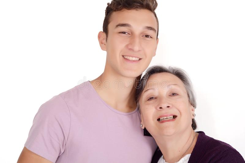 Grandmother with her teen grandson. Family concept. Isolated white background stock images