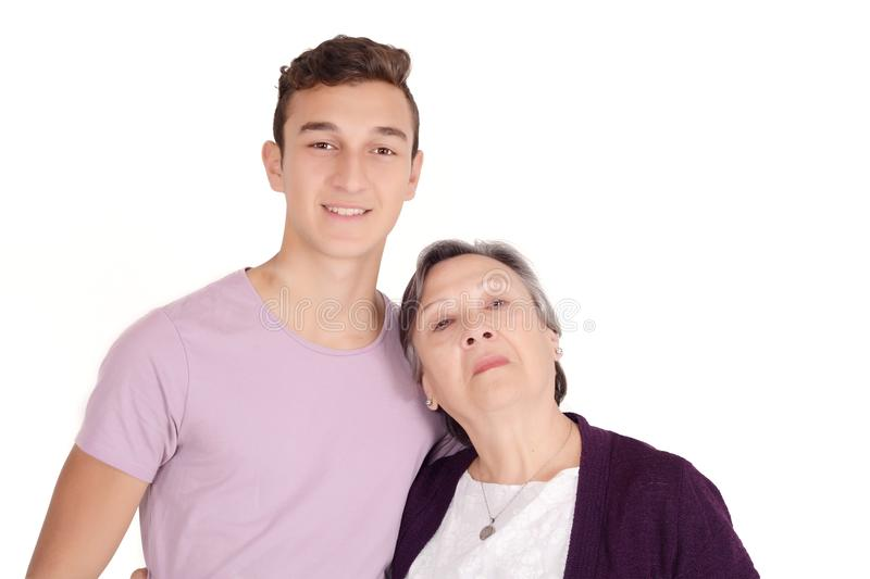 Grandmother with her teen grandson. Family concept. Isolated white background stock photo