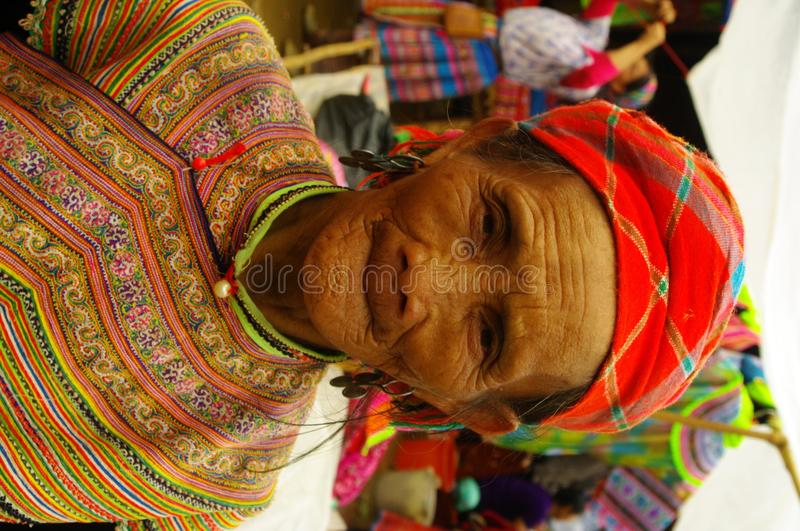 Grandmother Hmong flower. Hmong women back from the market of Muong Khuong. Basket loaded, the eternal umbrella for sun protection such as thunderstorms stock image
