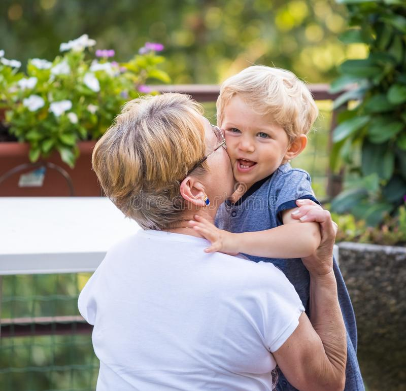 Grandmother hugs and lovely kisses stock image