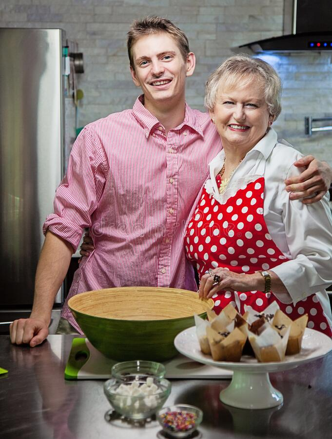 Free Grandmother In Kitchen With Her Grandson Royalty Free Stock Images - 189605869