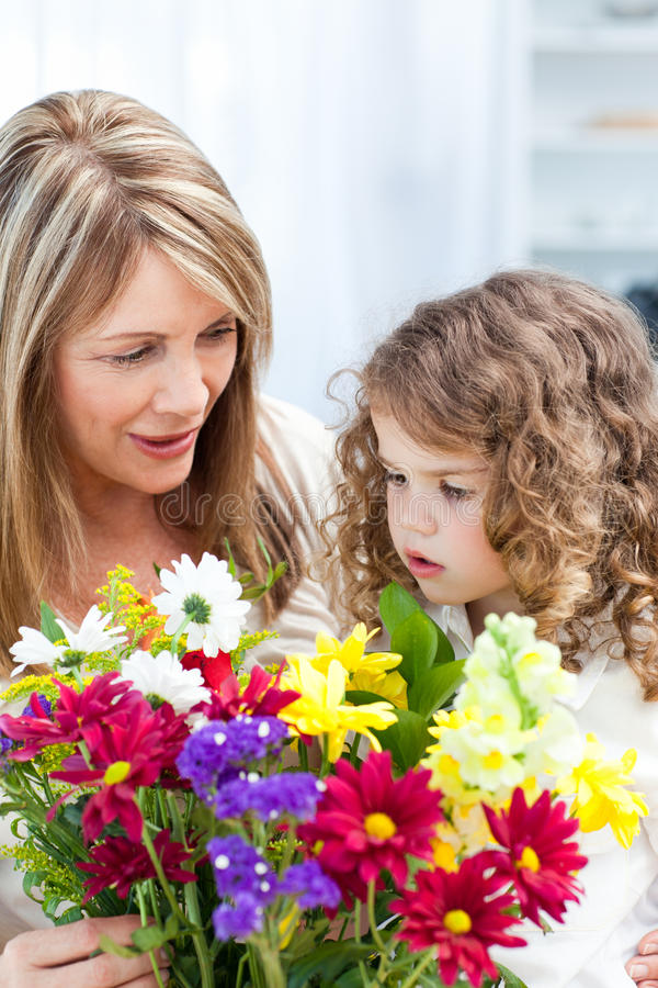 Download Grandmother With A Little Girl With Flowers Stock Image - Image of elegance, girl: 18109365