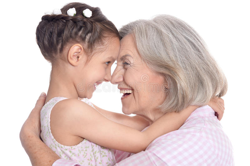 Grandmother and little granddaughter. Portrait of grandmother and little granddaughter on white background royalty free stock image