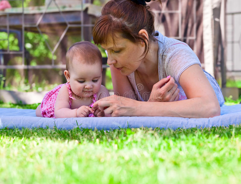 Grandmother. Middle aged women with a little girl in the garden stock photos