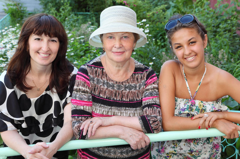 Grandmother, Mother, Daughter Near Cottage Royalty Free Stock Photos