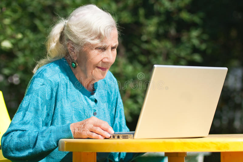 The grandmother with notebook. Portrait of grandmother with notebook stock image
