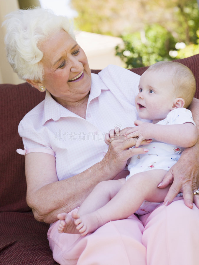 Download Grandmother Outdoors On Patio With Baby Stock Image - Image: 5939909
