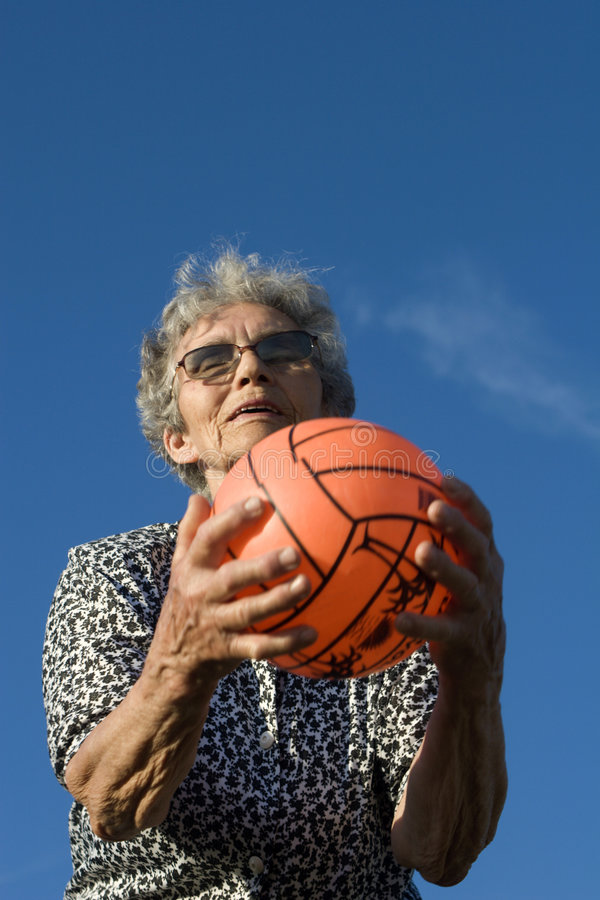 Grandmother by play with the ball royalty free stock photos