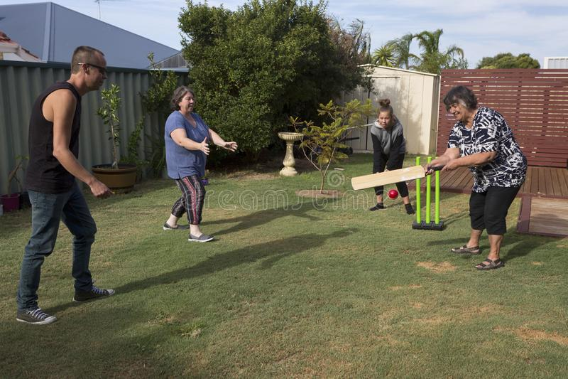 Grandmother Playing Cricket royalty free stock images