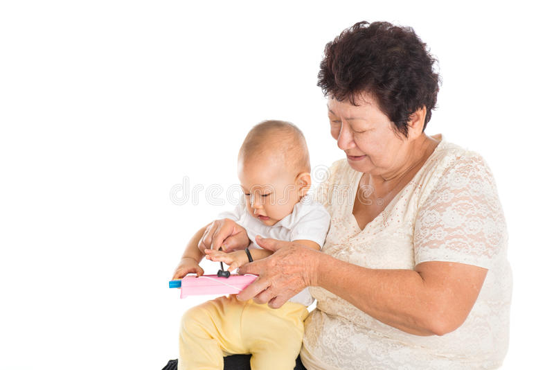Grandmother playing with grandchild stock photos