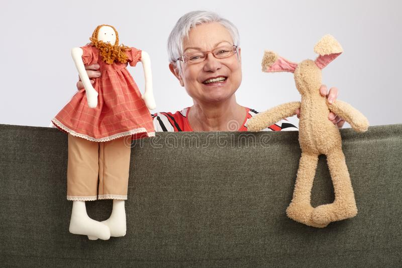 Grandmother presenting a puppet show royalty free stock photography