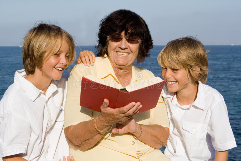 Grandmother reading stock photography