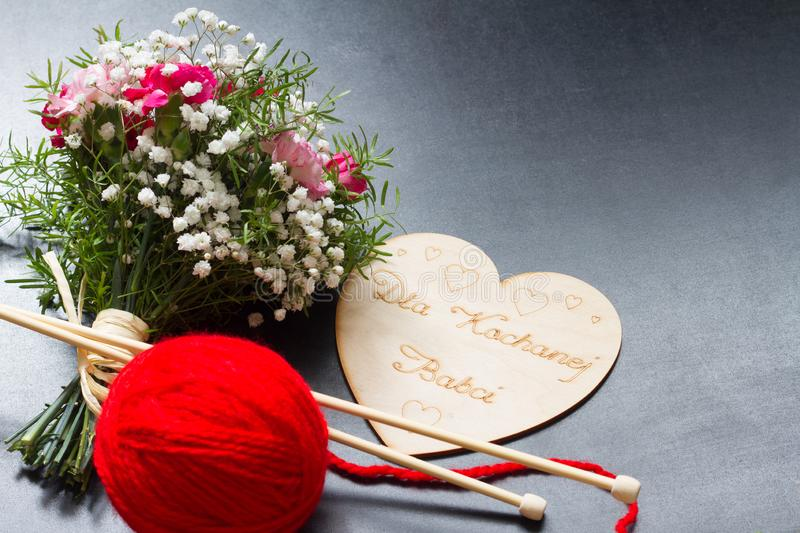 Grandmother`s day with flowers and greetings in heart. Concept royalty free stock images