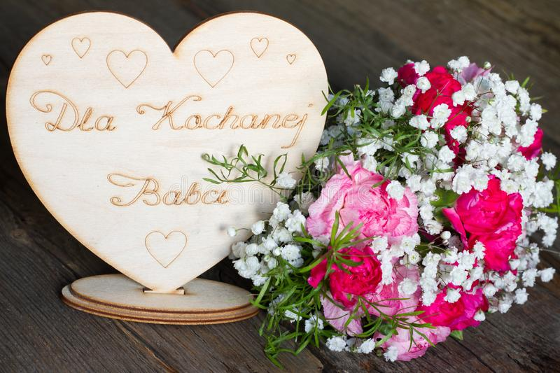 Grandmother`s day with flowers and greetings in heart. Concept royalty free stock image