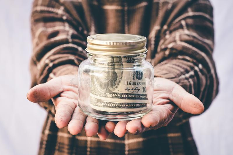 Grandmother`s hand saving money, Concept save money for the future.  royalty free stock image