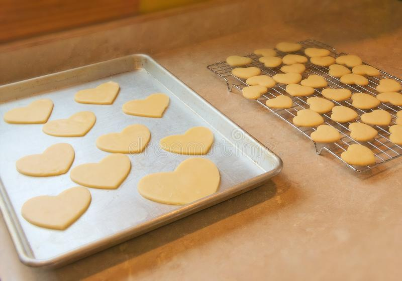 Grandmother`s homemade Valentine sugar cookies on cooling rack royalty free stock images