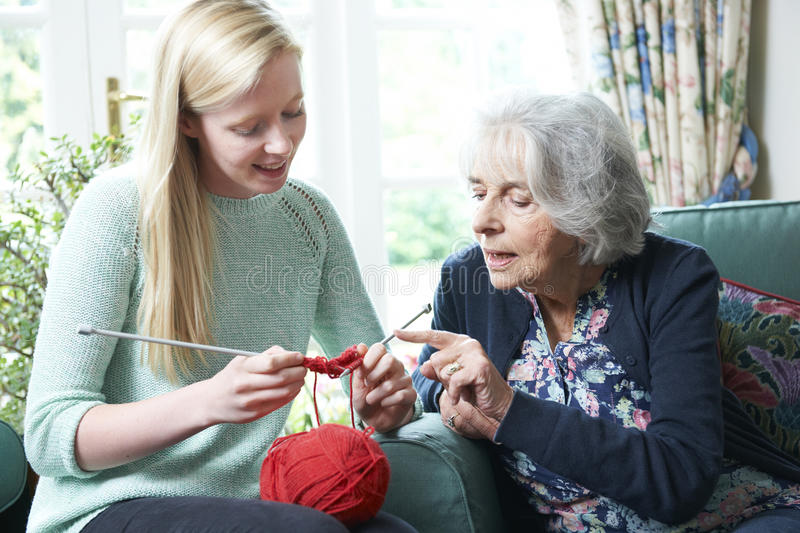 Grandmother Showing Granddaughter How To Knit. Grandmother Teaching Granddaughter How To Knit royalty free stock photos