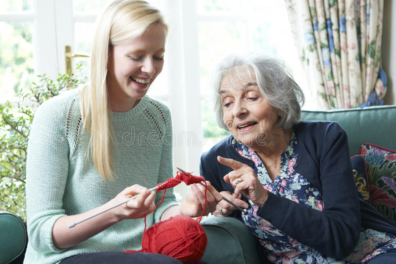 Grandmother Showing Granddaughter How To Knit. Grandmother Teaching Granddaughter How To Knit stock photos