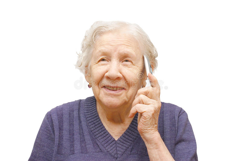 Grandmother talking with a mobile phone. On white background stock images