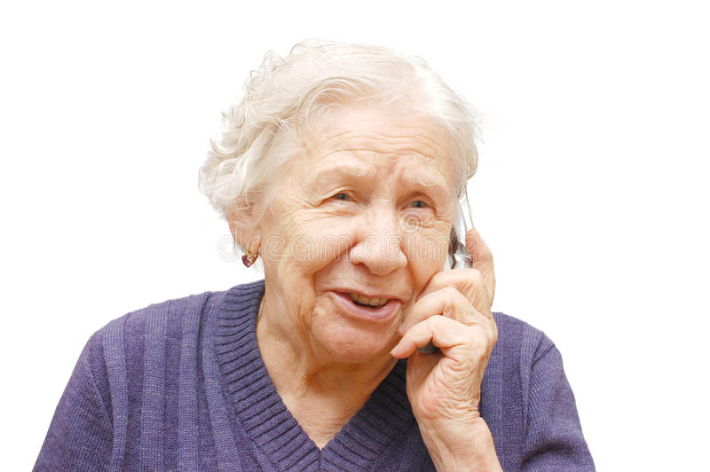 Grandmother talking with a mobile phone. Isolated white stock image