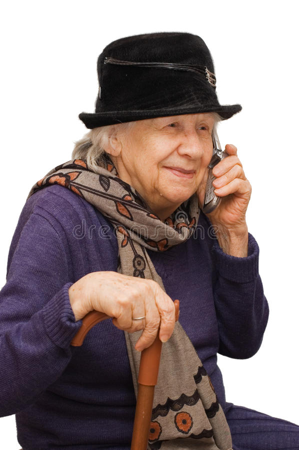 Grandmother talking with a mobile phone. Isolated over white royalty free stock image
