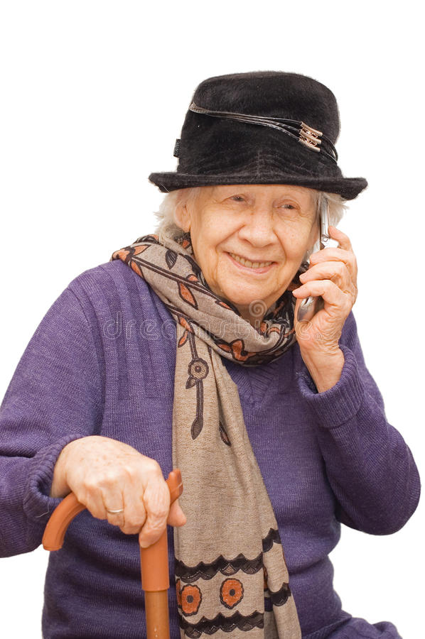 Grandmother talking with a mobile phone. Isolated over white stock photos