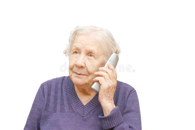 Grandmother talking with a phone. Isolated white stock photography