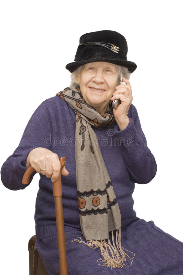 Grandmother talking with a phone. Grandmother talking with a mobile phone stock photography