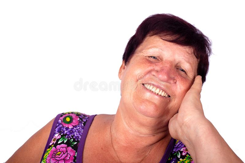 Grandmother talking on the phone and laughing. Closeup royalty free stock photography
