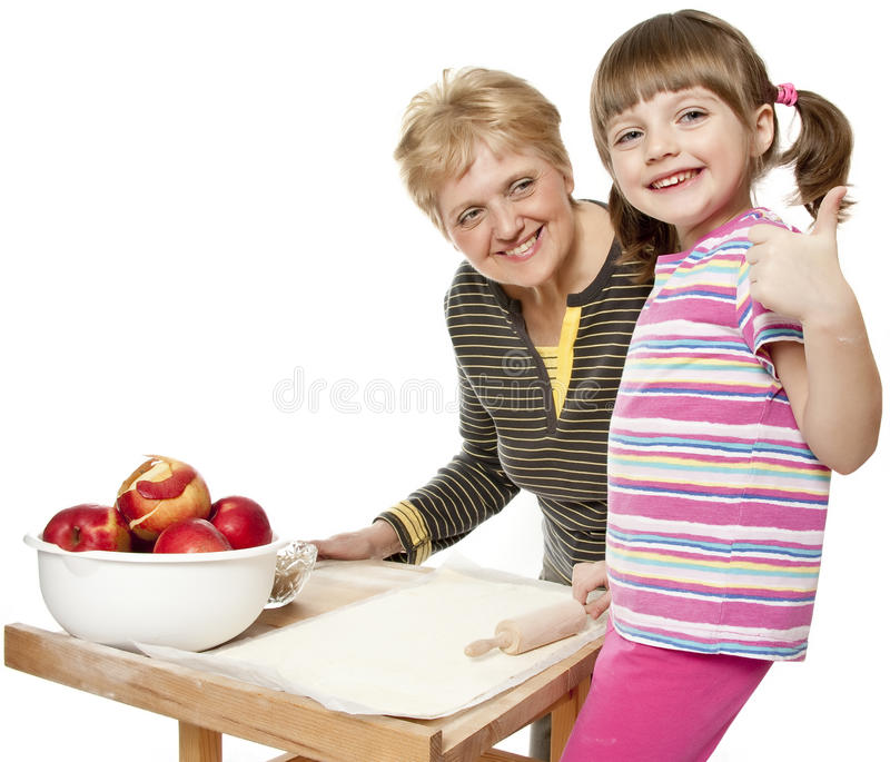 Download Grandmother Teaching Her Granddaughter Cooking Stock Image - Image of family, background: 23247527