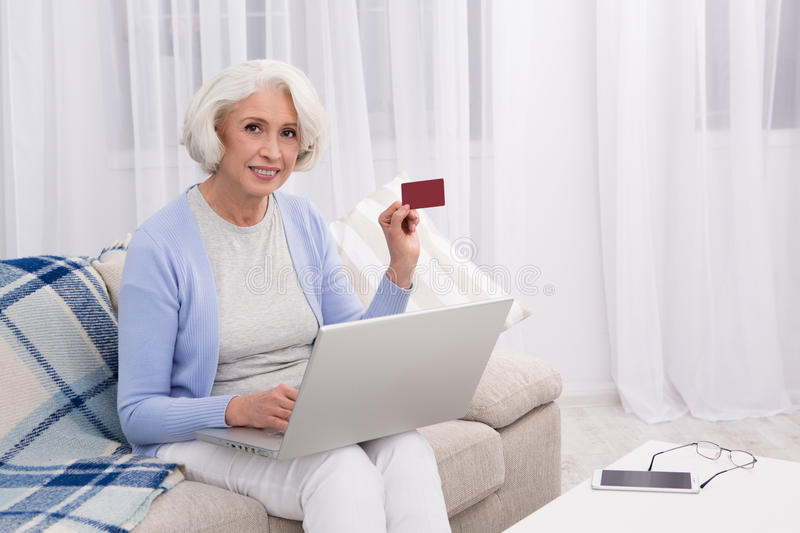 Grandmother visiting online store royalty free stock photos