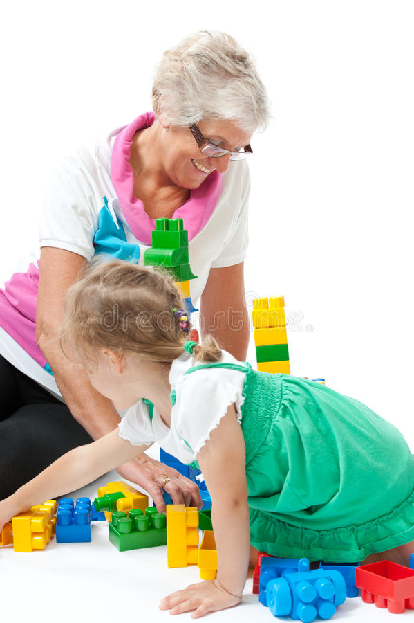 Free Grandmother With Grandchildren Playing With Blocks Royalty Free Stock Image - 25288296
