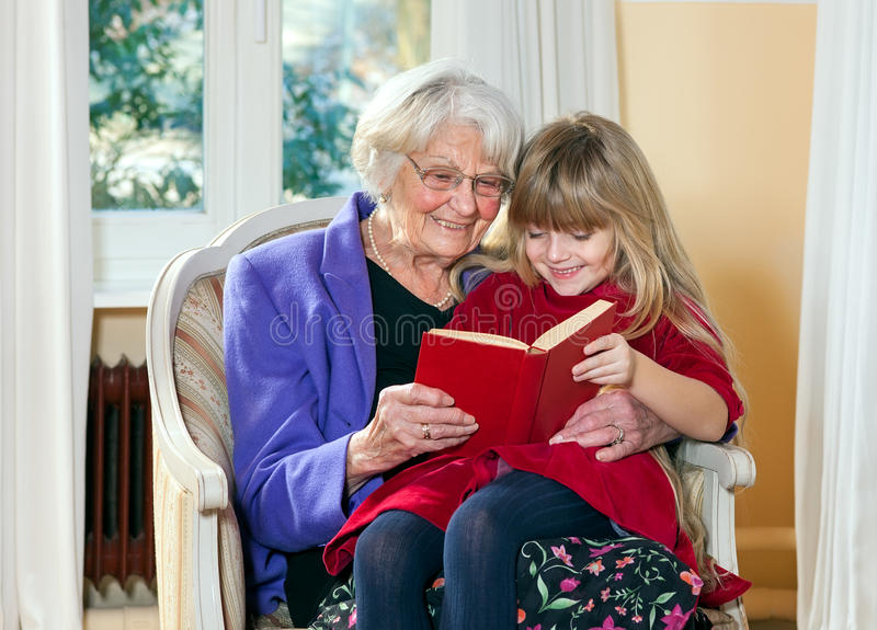 Grandmother and Young Girl Reading stock photography