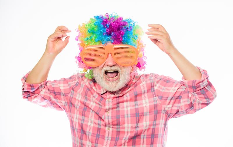 Grandpa always fun. Man senior bearded cheerful person wear colorful wig and sunglasses. Elderly clown. Having fun stock photos