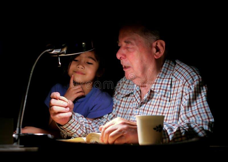 Grandpa and granddaughter stock photo