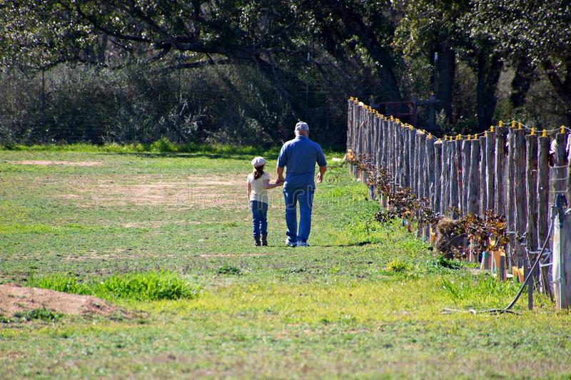 Grandpa and granddaughter talking in the pasture royalty free stock photos
