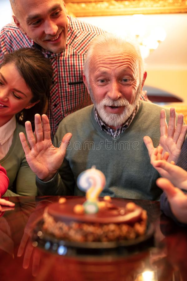 Grandpa making a wish for his birthday royalty free stock photography