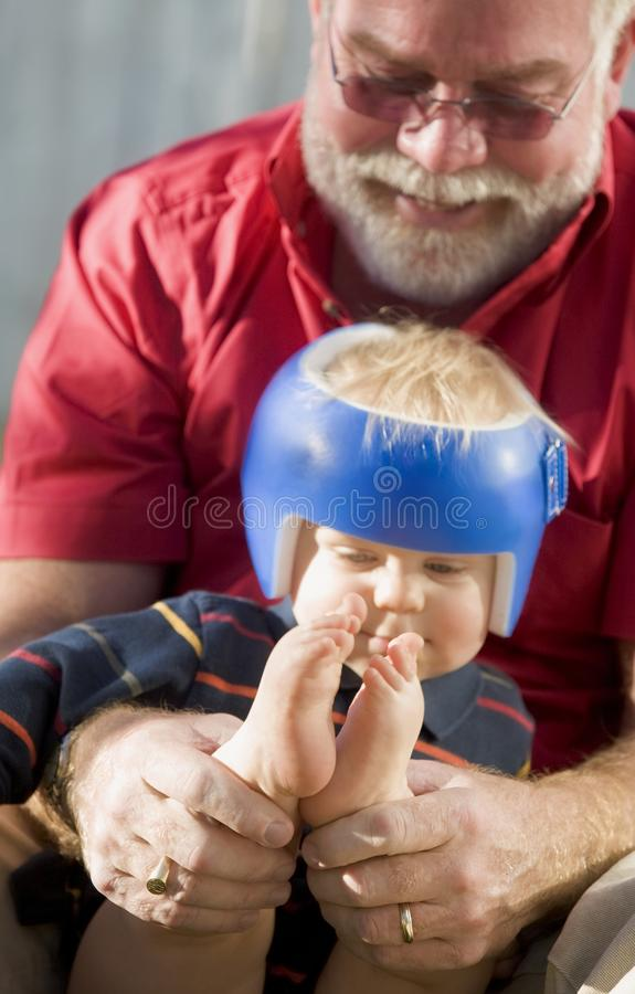 Grandpa Playing With Grandson Stock Photo