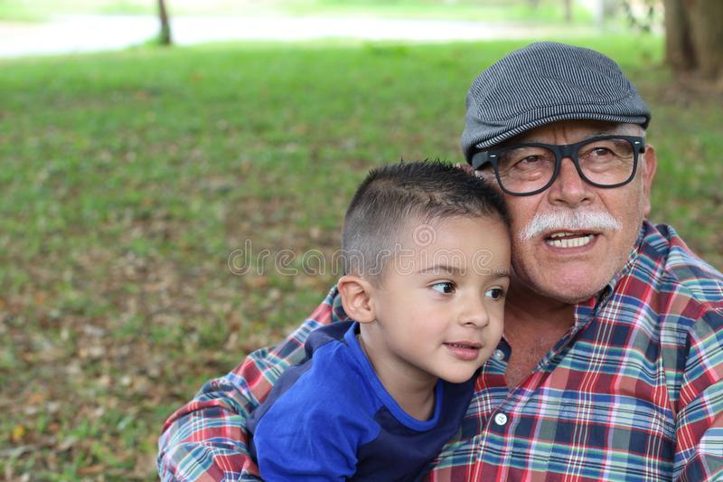 Grandpa telling stories to grandson stock photo